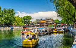Boats on Qianhai lake in Shichahai scenic area of Beijing. Beijing, China - May 15, 2016: Boats on Qianhai lake in Shichahai scenic area of Beijing Royalty Free Stock Photo