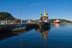 Boats on the quay at the port of halden Stock Image