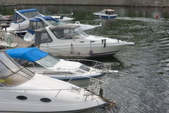Boats on the quayside. Fishing boats on quayside lake recreation vacation Royalty Free Stock Photo