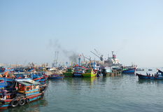 Boats at Qui Nhon Fish Port, Vietnam in the morning. Royalty Free Stock Photography