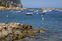 Boats on a quiet Mediterranean summer coast scene Royalty Free Stock Photography
