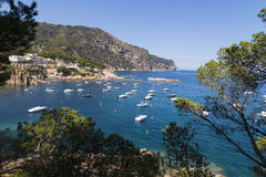 Boats on a quiet Mediterranean summer coast scene Royalty Free Stock Image