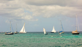 Boats racing in an annual competition in the caribbean Stock Photography