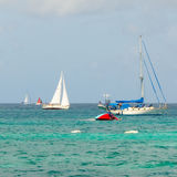 Boats racing in an annual competition in the caribbean Royalty Free Stock Image