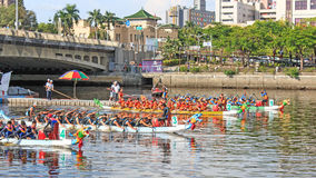 Boats racing in the Love River for the Dragon Boat Festival in Kaohsiung, Taiwan. Stock Images