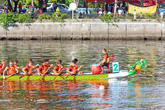 Boats racing in the Love River for the Dragon Boat Festival in Kaohsiung, Taiwan. Royalty Free Stock Photo