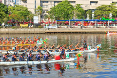 Boats racing in the Love River for the Dragon Boat Festival in Kaohsiung, Taiwan. Royalty Free Stock Photos