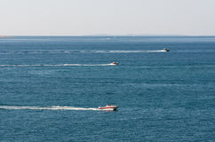 Boats racing in the sea. Three boats racing in the sea Royalty Free Stock Image