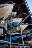 Boats in rack storage Stock Photos