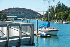 Boats and the Rainbow Bridge Royalty Free Stock Images
