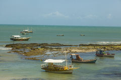Boats on a reef Stock Photo