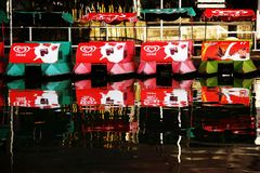 Boats reflected in water. At park Stock Photography