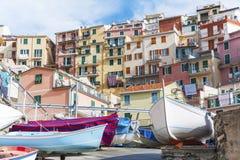Idyllic landscape of Cinque Terre, Italy. Boat for Rent at Village Riomaggiore in Cinque Terre, Liguria, Italy stock photo