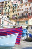 Idyllic landscape of Cinque Terre, Italy. Boat for Rent at Village Riomaggiore in Cinque Terre, Liguria, Italy royalty free stock photos