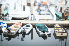 Boats at rest in the marina. Tilt-shift photography Royalty Free Stock Photos