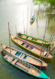 Boats rest on the riverbank in evening Royalty Free Stock Photo