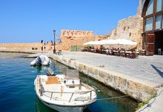 Boats and restaurants in the harbour, Chania. Royalty Free Stock Photo