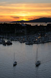 Boats return at sunset. Boats entering harbor. Vancouver, BC, Canada Royalty Free Stock Images