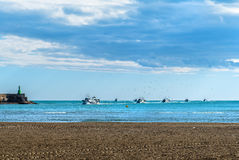 Boats returning from fishing to the port Stock Photography