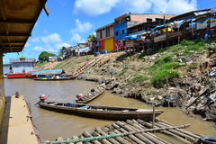 Boats in a river in the Amazon jungle, Peru. Some fisherman boats in the Amazon river, in the town of Nauta, next to Iquitos, Peru.n stock photo