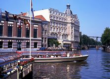 Boats on River Amstel, Amsterdam. Stock Photos