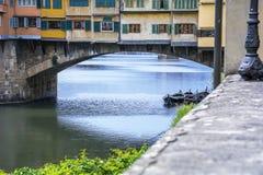 Boats on the River Arno near the Ponte Vecchio Stock Image