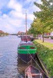Boats in a river of Belgium Stock Photos