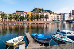 Boats on the river in Bosa in Sardinia. Fishing boats on the river in Bosa in Sardinia Stock Photos