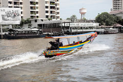 Boats. On the river and buildings in the city center of Thailand Royalty Free Stock Photography