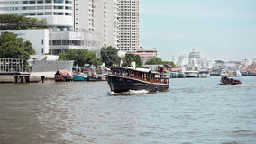 Boats. On the river and buildings in the city center of Thailand Royalty Free Stock Photos
