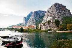 Boats on the river Cetina in the small town Omis Stock Photo