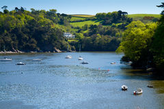 Boats on the River Dart near Dartmouth, Devon. Boats on the River Dart near Dartmouth near Dartmouth Devon, England.Photo taken from the road on the way to the royalty free stock images