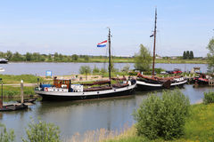 Boats on the river with a dutch flag Royalty Free Stock Photos