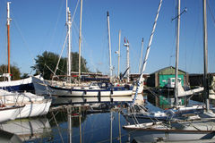Boats on River Exe. Moored yachts reflected in River Exe Stock Image