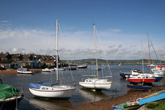 Boats on River Exe. View of moored boats on River Exe Stock Images