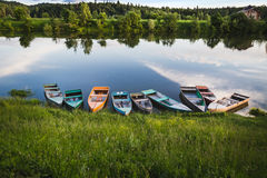Calm landscape. Few colorful boats on the calm water royalty free stock photo