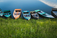 Boats on the river. Few colorful boats on the calm water royalty free stock photo