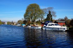 Boats On The River, Henley-on-Thames. Boats moored on the river Thames close to the town of Henley-on-Thames, Oxfordshire royalty free stock photo