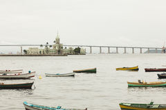 Boats in river infront of castle in Rio De Janeiro Royalty Free Stock Photography
