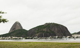 Boats in river infront of Sugarloaf mountain Stock Images