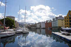 Boats in a river near buildings. In Norway Royalty Free Stock Image