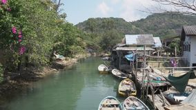 Boats on the river near the fishing village on Koh Chang stock video