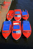 Boats on the river Ouse. Red, white and blue boats on river Ouse in York Stock Photo