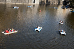 Boats on the river. Boats and pedalos on the river Vltava, Prague stock photos