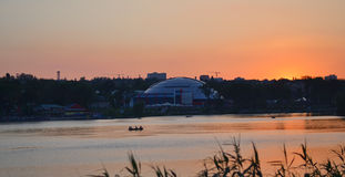 Boats on the river at sunset on the background of the big dome Stock Photo