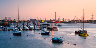 Boats on river Thames in North Greenwich. Royalty Free Stock Photography