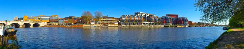 Panoramic view of  the River Thames. A panoramic photo of the river Thames at Kingston upon Thames, Surrey with the shore line  and Kingston bridge in the Royalty Free Stock Image