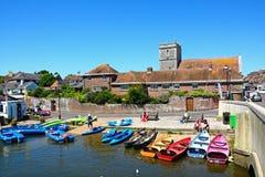 Boats on the riverbank, Wareham. Stock Photos