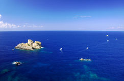 Boats and rock beside Corfu island Royalty Free Stock Photo
