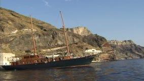 Boats at rocks of Santorini. Greece. stock video footage
